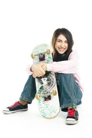 happy teenage girl wearing earphones and holding a skate board Stock Photo