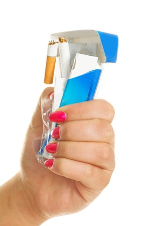 rumple: closeup of the hand of a young woman rumpling a pack of cigarettes