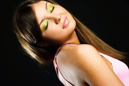 studio portrait of a beautiful brunette model with colorful makeup   photo