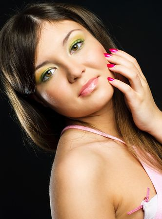 studio portrait of a pretty brunette model with colorful makeup and beautiful nails photo