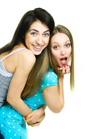 two young surprised women looking at something photo