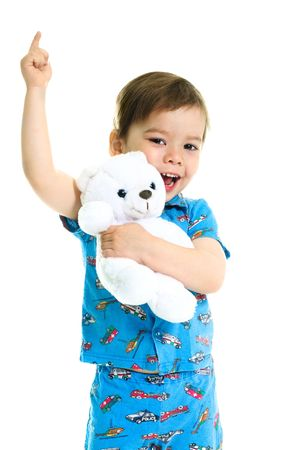 persuade: cute little three year old boy with his hand up holding a toy bear  Stock Photo