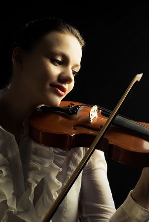 portrait of a pretty young woman playing the violin Stock Photo