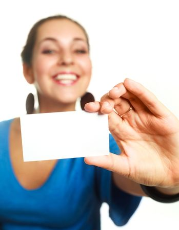 young cheerful businesswoman showing us a business card (focus on the card) photo