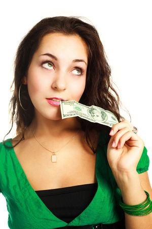 hesitations: beautiful young dreamy woman with one hundred dollar banknote