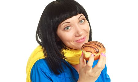 pretty young brunette woman eating a roll with chocolate Stock Photo - 5002392