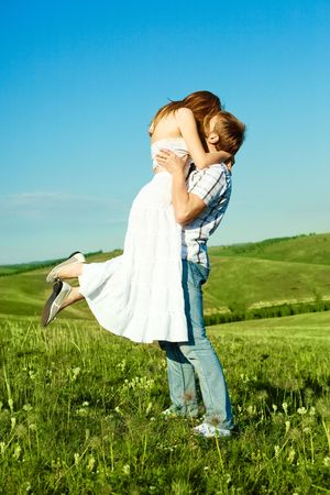 happy young loving couple kissing outdoor in summertime Stock Photo - 5002453