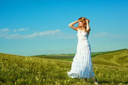 beautiful girl wearing a white dress outdoor in summertime Stock Photo - 5002462