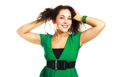 underarms: portrait of a beautiful happy young brunette woman against white background