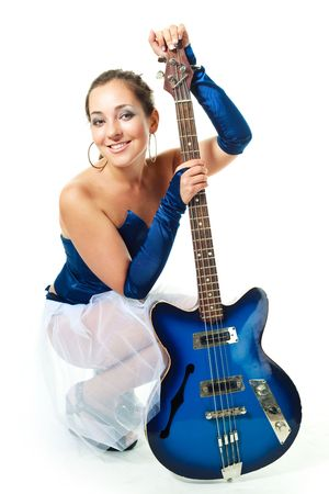 female sexuality: sexy young brunette woman with a guitar against white background