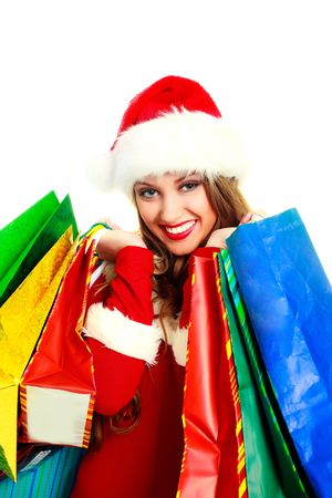 portrait of a sexy young woman dressed as Santa with many shopping bags Stock Photo - 5721370