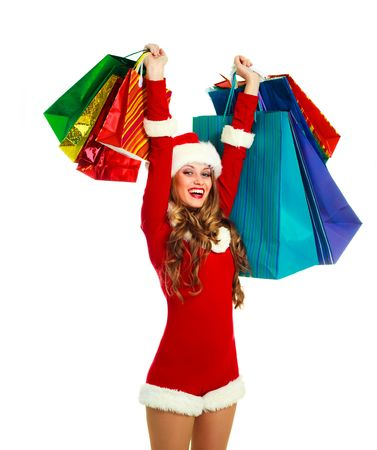 portrait of a sexy young woman dressed as Santa with many shopping bags Stock Photo - 5721344