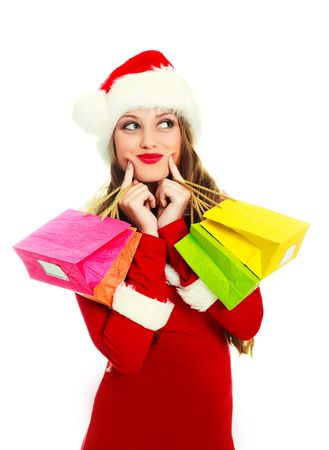 portrait of a sexy young woman dressed as Santa with many presents photo