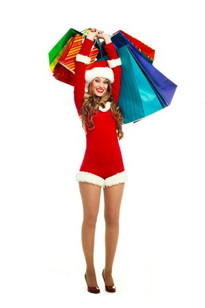 portrait of a sexy young woman dressed as Santa with many shopping bags photo