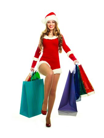 happy young blond woman dressed as Santa with many shopping bags photo