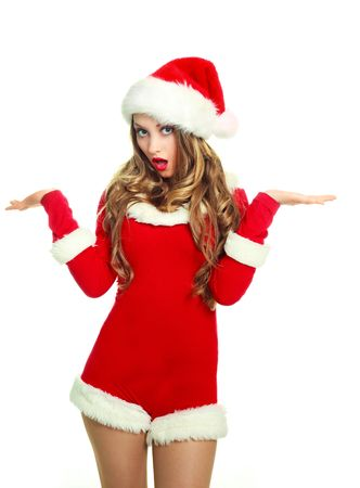 hesitations: portrait of a surprised young woman  dressed as Santa against white background Stock Photo