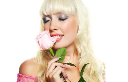 portrait of a beautiful young blond woman biting a a rose photo