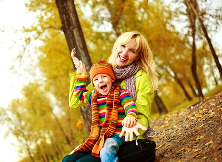 happy young beautiful mother with her little son in the park  photo