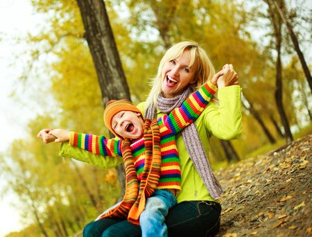 outsides: happy young beautiful mother with her little son in the park