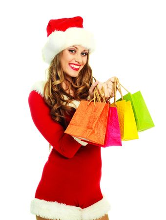portrait of a sexy young woman dressed as Santa with many small shopping bags Stock Photo - 5792527