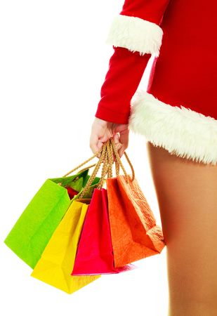 slim girl dressed as Santa with Christmas presents against white background photo