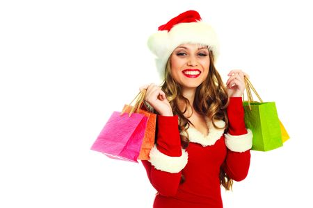 portrait of a sexy young woman dressed as Santa with many small shopping bags Stock Photo - 5792529