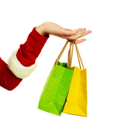 close up of the hand of a woman dressed as Santa holding two shopping bags Stock Photo - 5792519