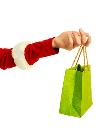 close up of the hand of a woman dressed as Santa holding a shopping bag photo