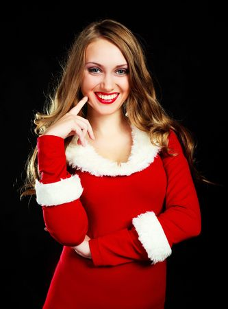 portrait of a sexy young woman with long hair dressed as Santa photo