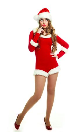 beautiful thoughtful sexy girl dressed as Santa against white background photo
