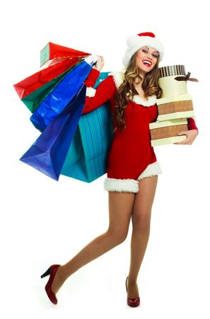 portrait of a sexy young woman dressed as Santa with many shopping bags Stock Photo - 5792514