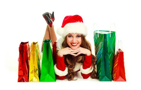 pretty young woman dressed as Santa with many shopping bags  photo