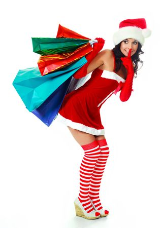 beautiful young brunette woman dressed as Santa with a lot of shopping bags Stock Photo - 5811638