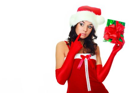 beautiful brunette girl shaking a present and trying to guess what is inside of it Stock Photo - 5811641