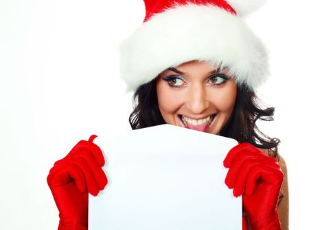 santas  helper: beautiful young brunette woman dressed as Santa licking an envelope to glue it