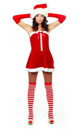 beautiful young surprised woman dressed as Santa against white background photo