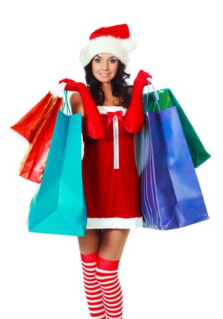 beautiful young brunette woman dressed as Santa with a lot of shopping bags photo
