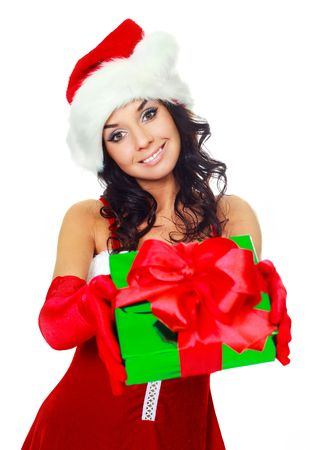 beautiful brunette girl dressed as Santa giving us a Christmas present photo