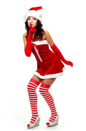 pretty young woman dressed as Santa telling a secret to us photo