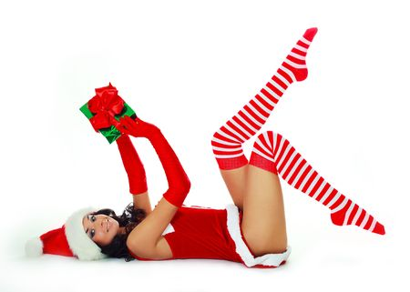 pretty brunette girl dressed as Santa with a Christmas present