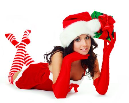 christmas sock: pretty brunette girl dressed as Santa with a Christmas present Stock Photo