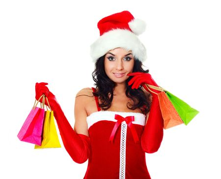 beautiful young brunette woman dressed as Santa with a lot of small shopping bags photo