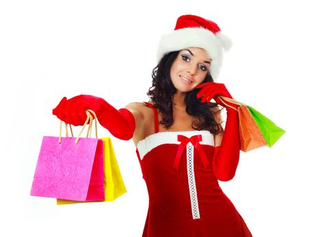 beautiful young brunette woman dressed as Santa giving us two small shopping bags photo