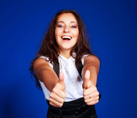 portrait of a beautiful young brunette woman with her thumbs up Stock Photo - 5848867