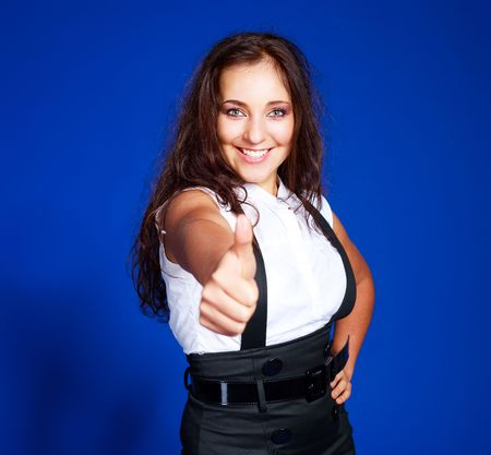portrait of a beautiful young brunette woman with her thumb up Stock Photo - 5848852