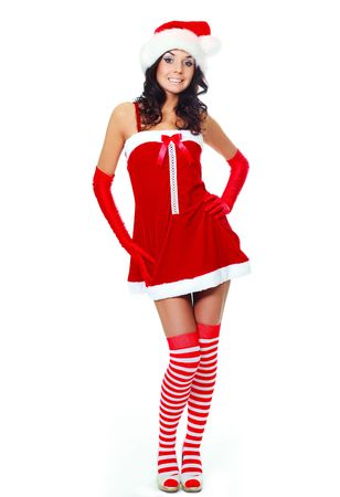 beautiful young brunette woman dressed as Santa against white background photo