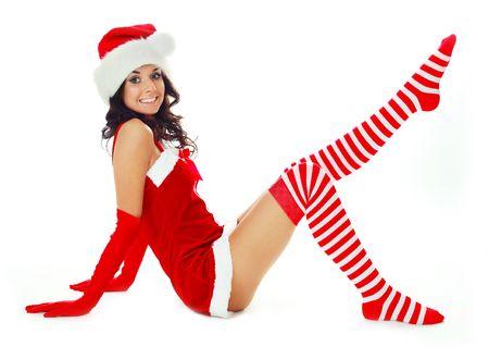 pretty brunette girl dressed as Santa on the floor photo