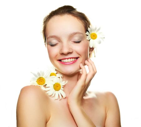 pretty laughing girl with many camomile flowers  photo