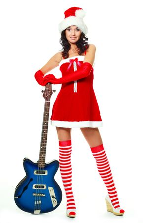 beautiful young brunette woman wearing a Santas hat and holding a guitar photo