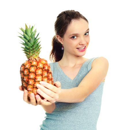 pretty young brunette woman giving us a pineapple photo